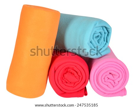 Rolled up blankets. Isolated - stock photo