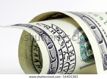 rolled up 100 dollar bill - stock photo
