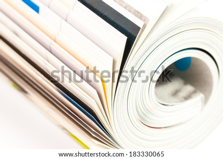 rolled up magazine - on white background - stock photo