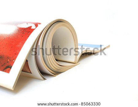 Rolled up magazine over white background - stock photo