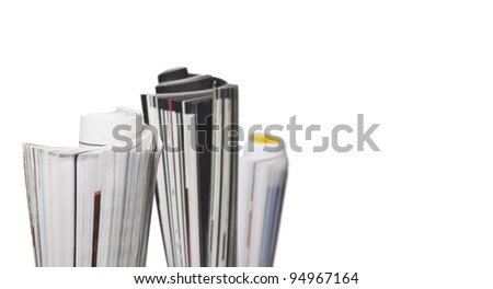 rolled up magazines, isolated on white background, free copy space - stock photo
