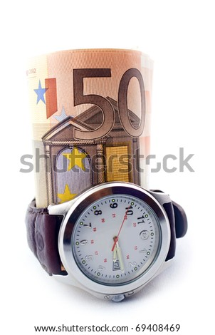 Rolled up money and a clock isolated on white - stock photo