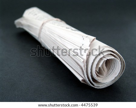 Rolled Up Newspaper - stock photo
