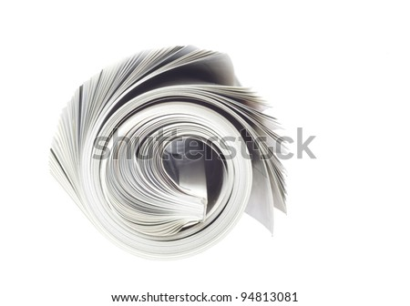 rolled up newspaper, isolated on white background, free copy space - stock photo