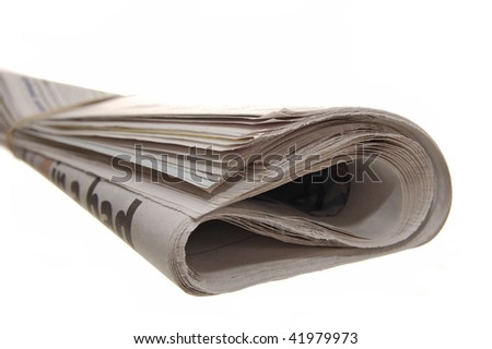 Rolled up newspaper on a white background - stock photo
