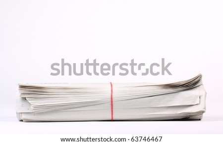 Rolled up newspaper on white background with copy space - stock photo