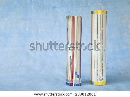 rolled up newspapers or magazines, free copy space - stock photo