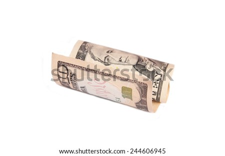 Rolled up ten dollar bill - stock photo