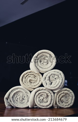rolled up white beach towel - stock photo