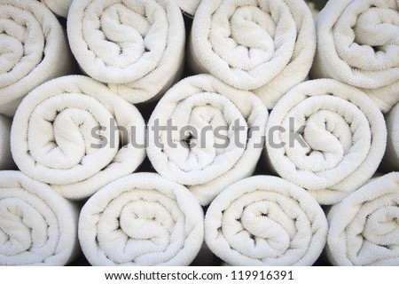 Rolled up white spa towels - stock photo