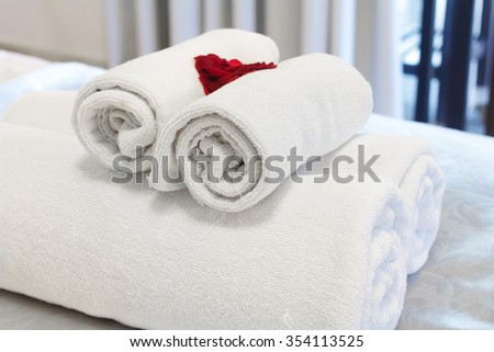 rolled up white towel 