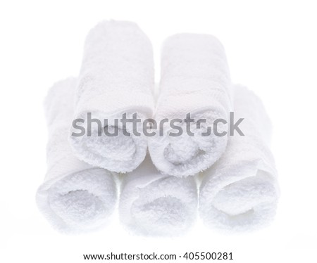 rolled up white towel on white background - stock photo