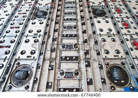 roller at floor inside air cargo freighter - stock photo