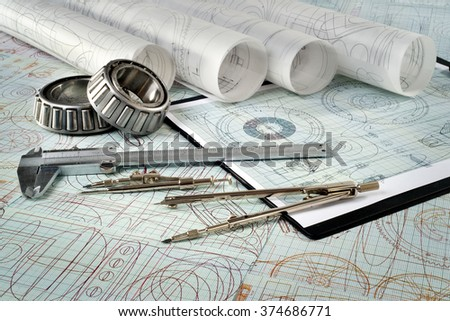 roller bearing, vernier callipers , compasses, clipboard and drawings
