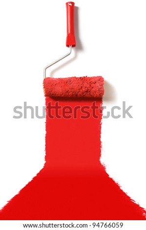 roller brush with red paint - stock photo