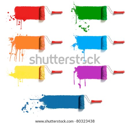 roller brushes with seven colors paint - stock photo