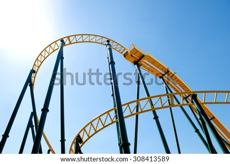 Roller Coaster against the sky. - stock photo