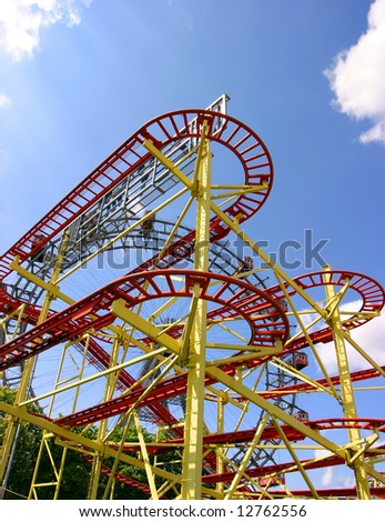 Roller coaster and large ferris wheel in Vienna - stock photo