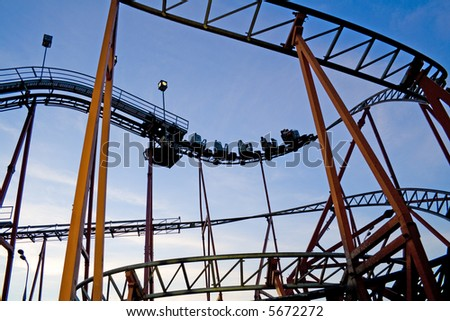 Roller coaster at an amusement park. Evening