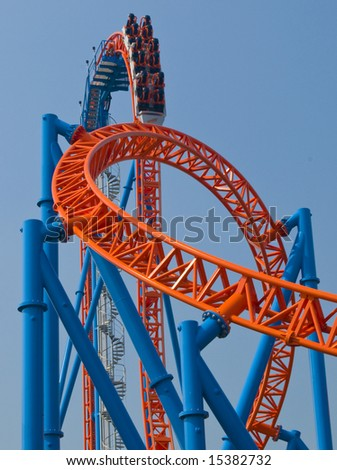 roller coaster in amusement park with vertical drop - stock photo