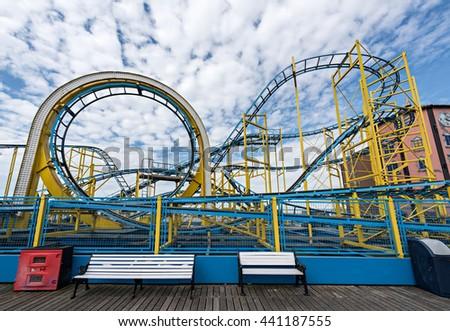 Roller Coaster on the amusement park - stock photo