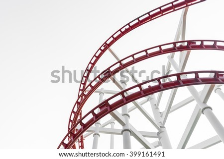 Roller coaster (red) in the amusement park isolated (copy space) - stock photo
