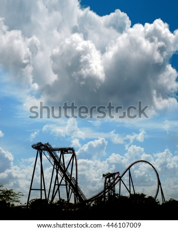 Roller Coaster silhouette over cloudy sky