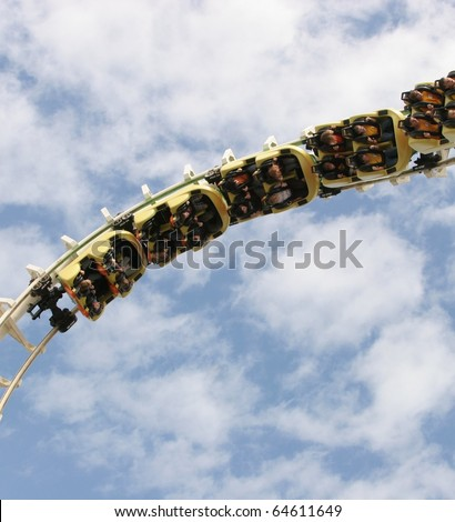 Roller coaster twisting upside down - stock photo
