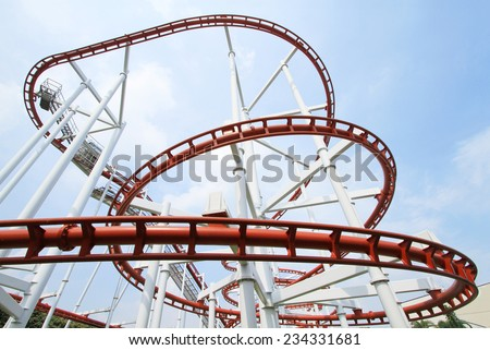 Roller coaster with blue sky background - stock photo