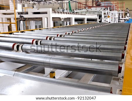 roller conveyer on a factory - stock photo