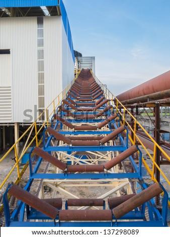 Roller conveyor in factory - stock photo