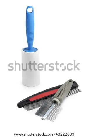 Roller for removing animal hair and hair brushes - stock photo