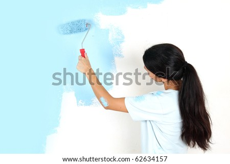 roller in woman hand - stock photo