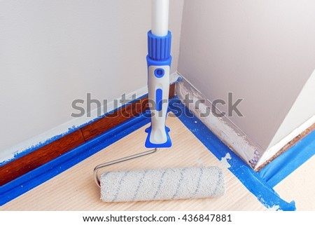 Roller Painter Closeup. House Interior Painting