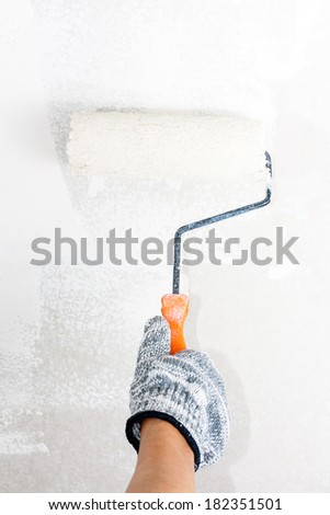 Roller painting wall - stock photo