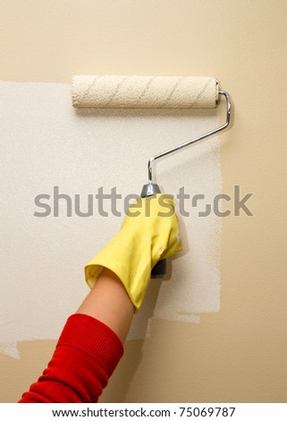 Roller painting wall on white color - stock photo