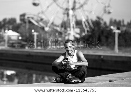 Roller sit in the park, relaxing  and listening to the music - stock photo