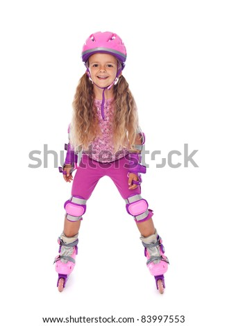 Roller skating little girl with protective gear, laughing - isolated - stock photo