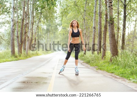 Roller skating sporty girl in otdoor. Caucasian woman in outdoor fitness activities. - stock photo