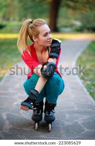 Roller sporty girl in park, woman outdoor fitness activities - stock photo