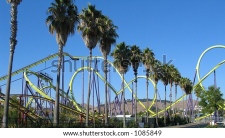 Rollercoaster and Palm Trees - stock photo