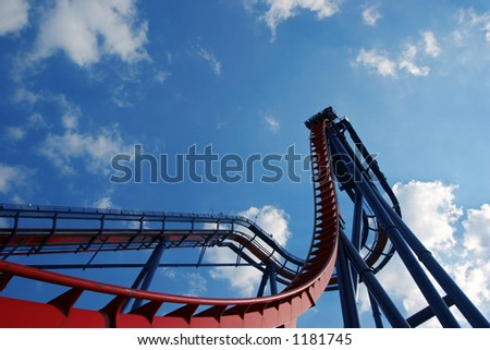 Rollercoaster coming off the highest point - stock photo
