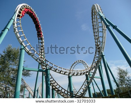 Rollercoaster in amusement park in summer - stock photo