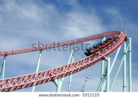 Rollercoaster park. Kart taking a curve. - stock photo