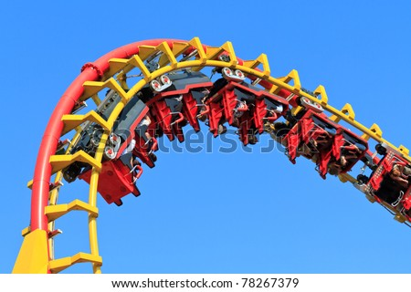 Rollercoaster Ride (against blue sky) - stock photo