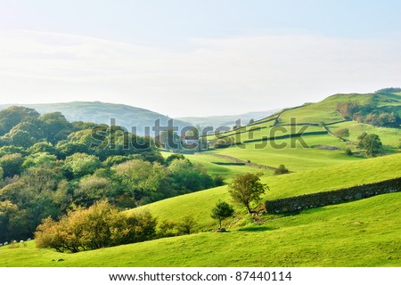Rolling countryside around a farm - stock photo