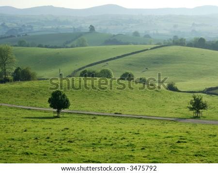 Rolling farmland near Kendal, Cumbria, UK - stock photo