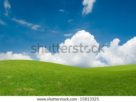 Rolling green hills under a blue summer sky. - stock photo