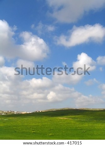 rolling hills with sky and clouds