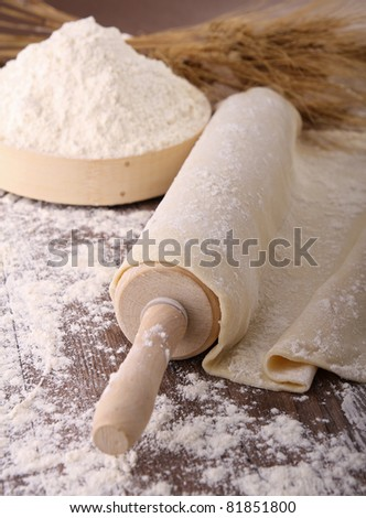 rolling pin and dough - stock photo
